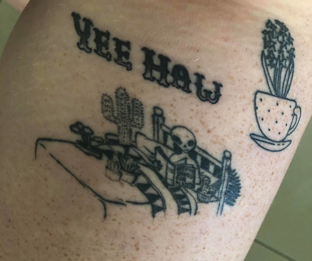 "Tiahn got a ""Yee Haw"" tattoo to commemorate the trip. Now THAT'S commitment."