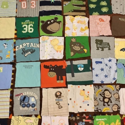Laying out a baby clothes quilt