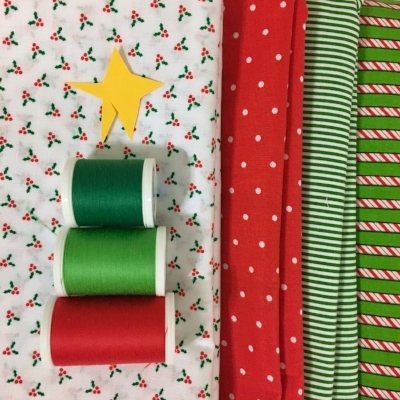 Fabrics to go with the Christmas PJ Quilt-- won't that peppermint fabric on the right make the BEST binding!