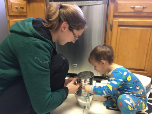 Jemsy got in on the action, sifting flour and sugar.