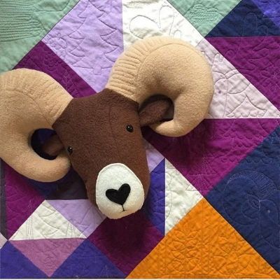 "I saw this quilt, ""Mountain Baby,"" at QuiltCon, too. Look at this cute ram pillow katie made based on the quilting!"