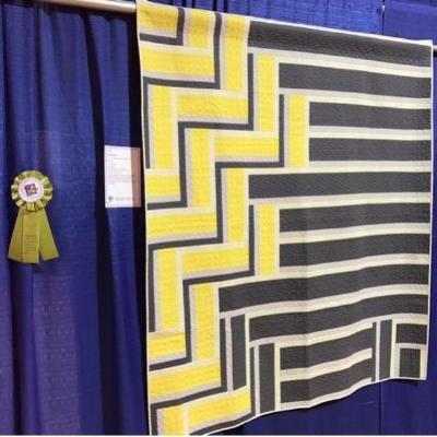 Christa's version of Plumb Lines from The Ultimate Guide of Machine Quilting with its honorable mention ribbon at MQX 2017. Pattern by Angela Walters.