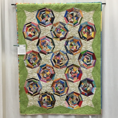 """String Spider Web"" by Jen Greer. Y'all, the quilting in those green borders is particularly amazing."