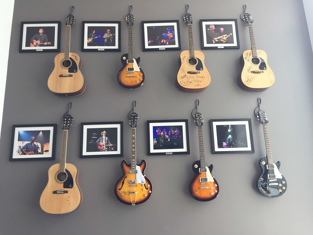 Back stage practice room decorated with past performers memorabilia