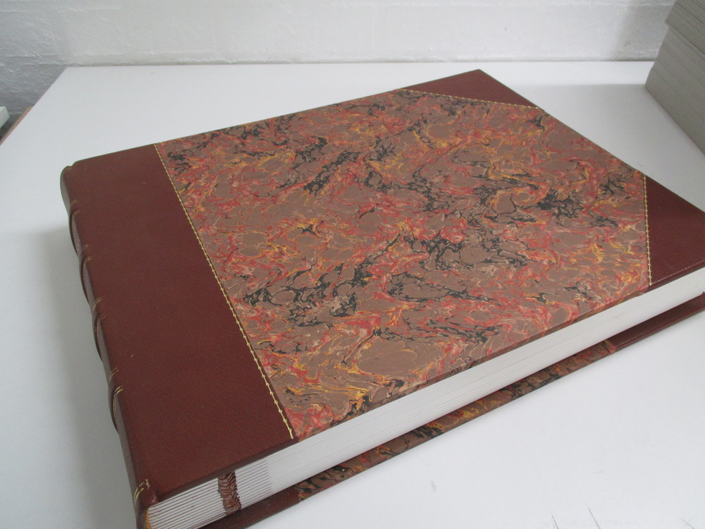 Quarter bound leather stationery book