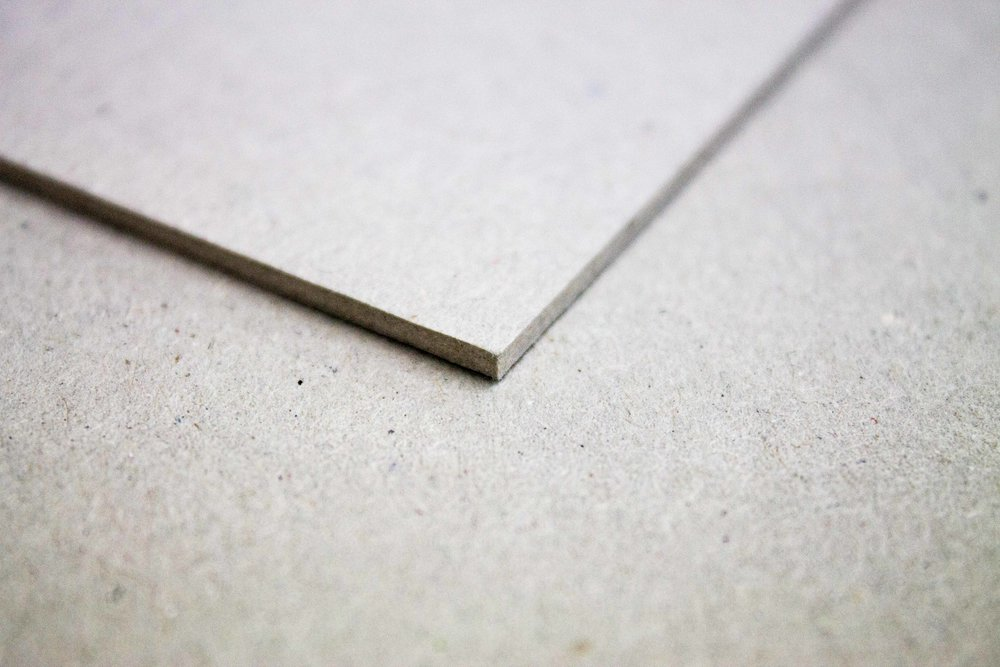 We stock grey board in a few different thicknesses.  3mm, 2mm & 1mm