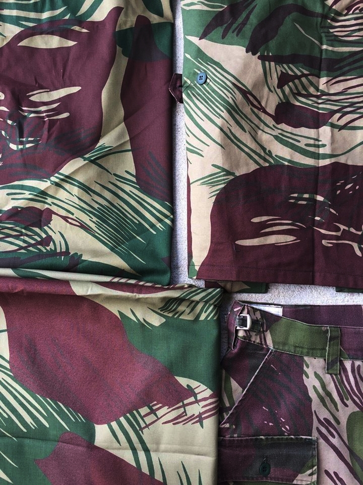 """Top Left: Original bolt of """"Rhodesian Brushstroke, 2nd Pattern"""" designed by Di Cameron of David Whitehead Textiles Ltd. in Salisbury, Rhodesia.   Top Right: Fireforce Ventures' very own Rhodesian Brushstroke Reproduction in a finished BDU Shirt, manufactured on a 1:1 scale   Bottom Left: Original bolt of Zimbabwe National Army produced Rhodesian Brushstroke. Notice the prominence of the light greens overlapping the browns.   Bottom Right: Civilian manufactured ADRO produced Rhodesian Brushstroke reproductions, manufactured shortly after the Rhodesian Bush War in South Africa. Notice the thicker """"brushstrokes""""."""