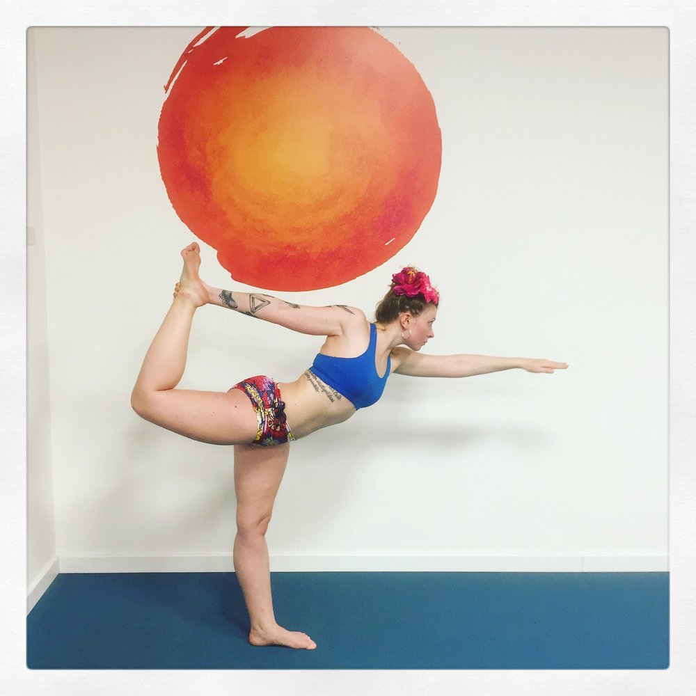 Standing bow Trieste yoga student