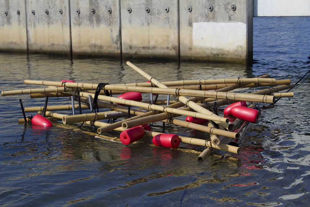 Margaret Noble, Tide Rattler, 2016 A partially submerged percussive raft made of vintage buoys, bamboo, and metal tubes.