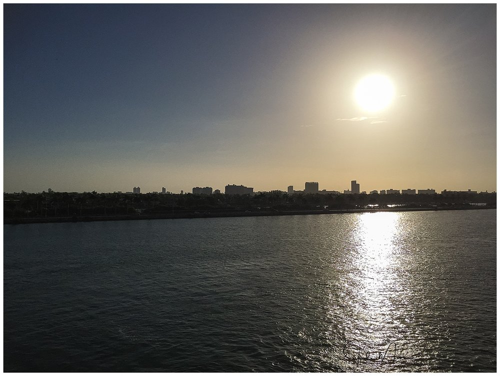 The sunrise view from our cabin balcony of Miami's cityscape, as the ship is pulling into the harbor. I miss sitting out on our balcony and listening to the soothing waves.