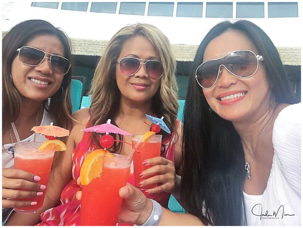 Selfie of Somala, me and Tina holding our Bahama Mama drinks!