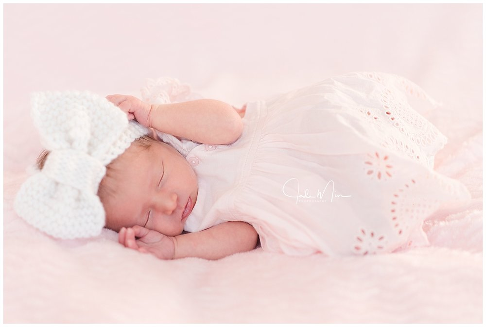 Baby Amelia is pretty in her dress for her newborn session at the Florez family home in Scottsdale, Arizona.
