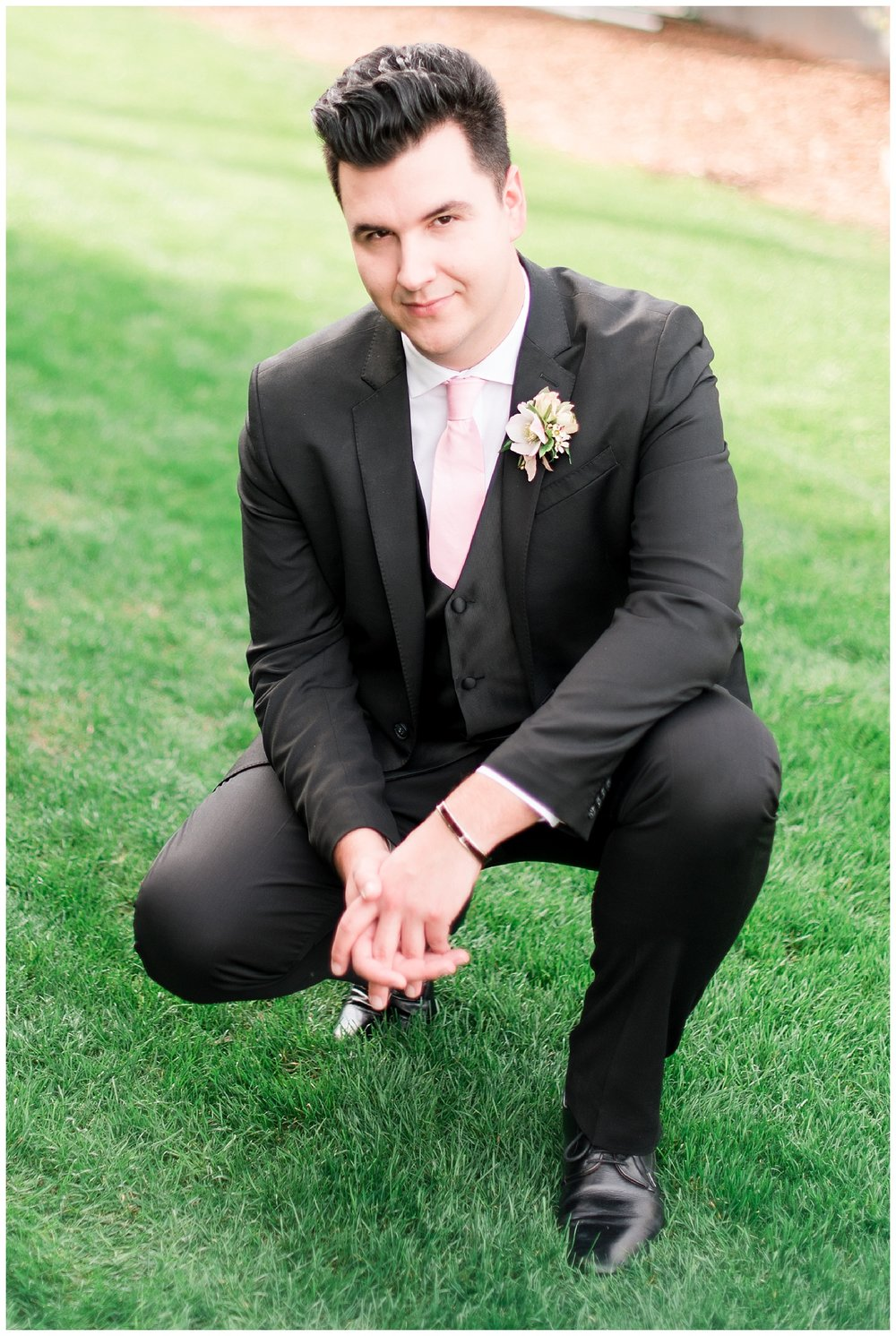 Groom Slaven wearing his own fitted and dashing suit, as well as a boutonniere made with love by Garden Gate Flowers, photographed at Gather Estate in Mesa, Arizona.