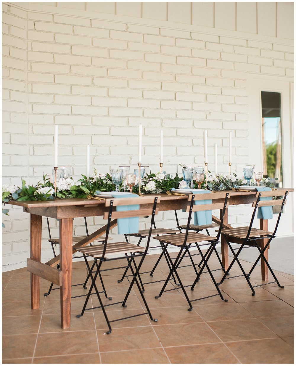 Reception table and rentals provided by Tremaine Ranch, decorated with florals and greenery by Golden Gate Flowers in Gilbert - photographed at Gather Estate in Mesa, Arizona.
