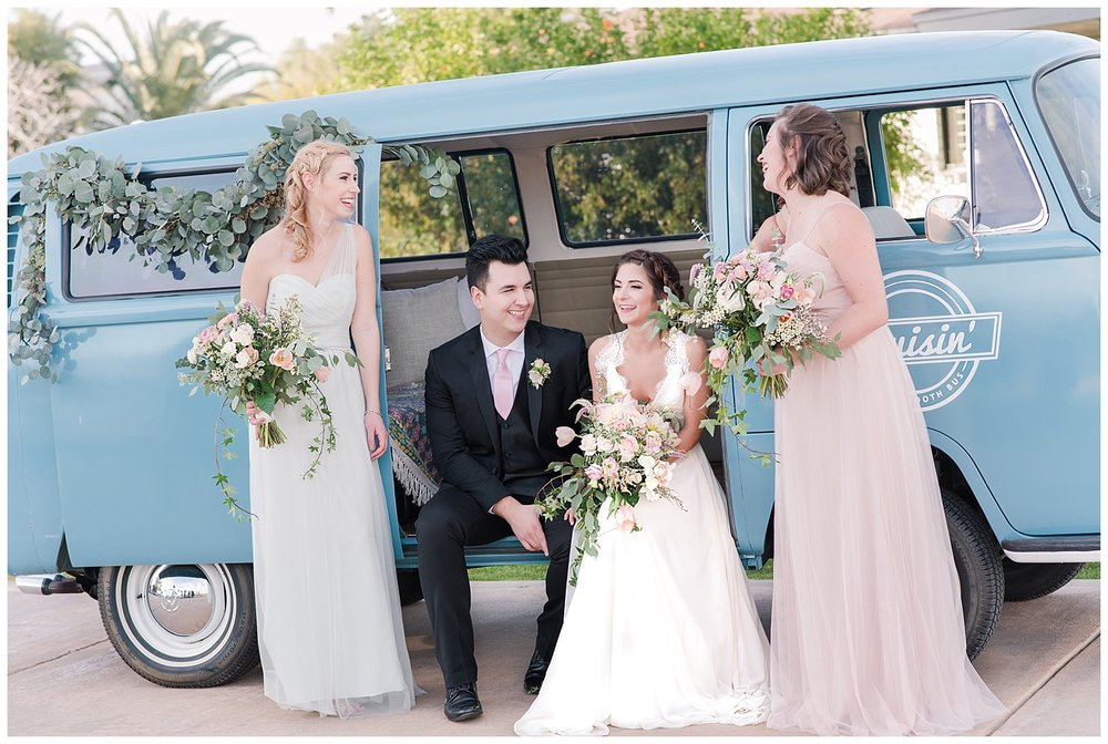 Bridesmaids and bride wearing dresses provided by Bella Lily Bridal in Phoenix and hanging out with groom Slaven inside Cruisin -  a Photo Booth Bus, photographed at Gather Estate in Mesa, Arizona.