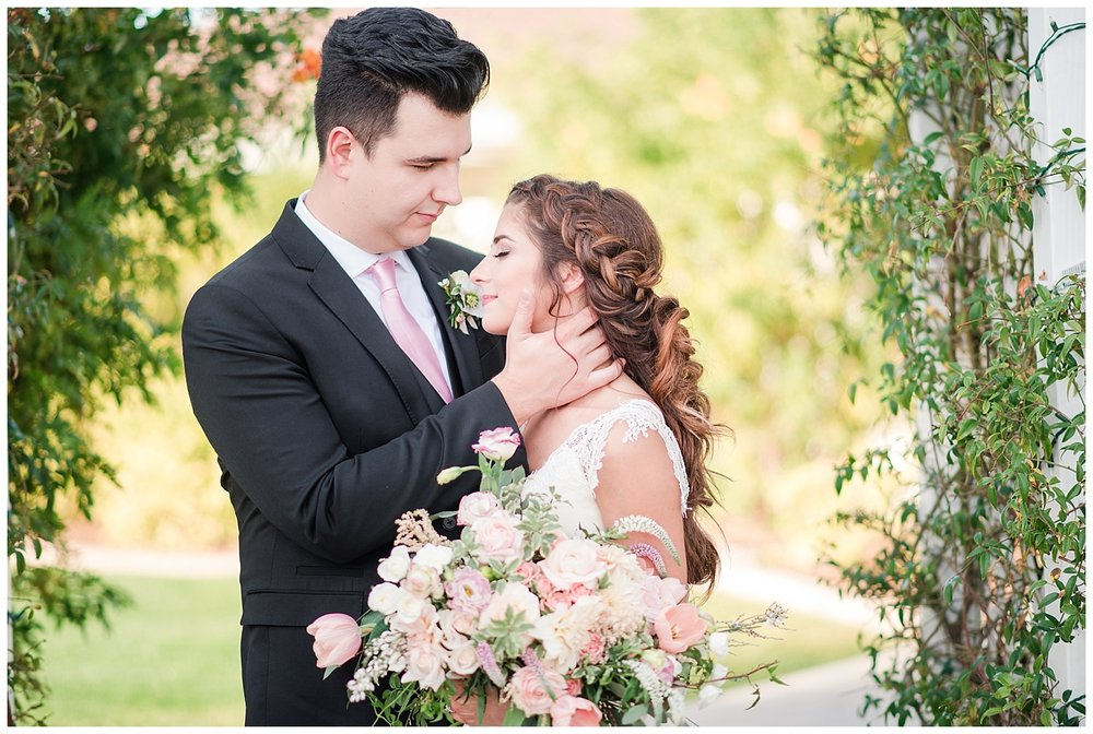 Bride Jessica wearing dress provided by Bella Lily Bridal in Phoenix, with groom Slaven, photographed at Gather Estate in Mesa, Arizona.