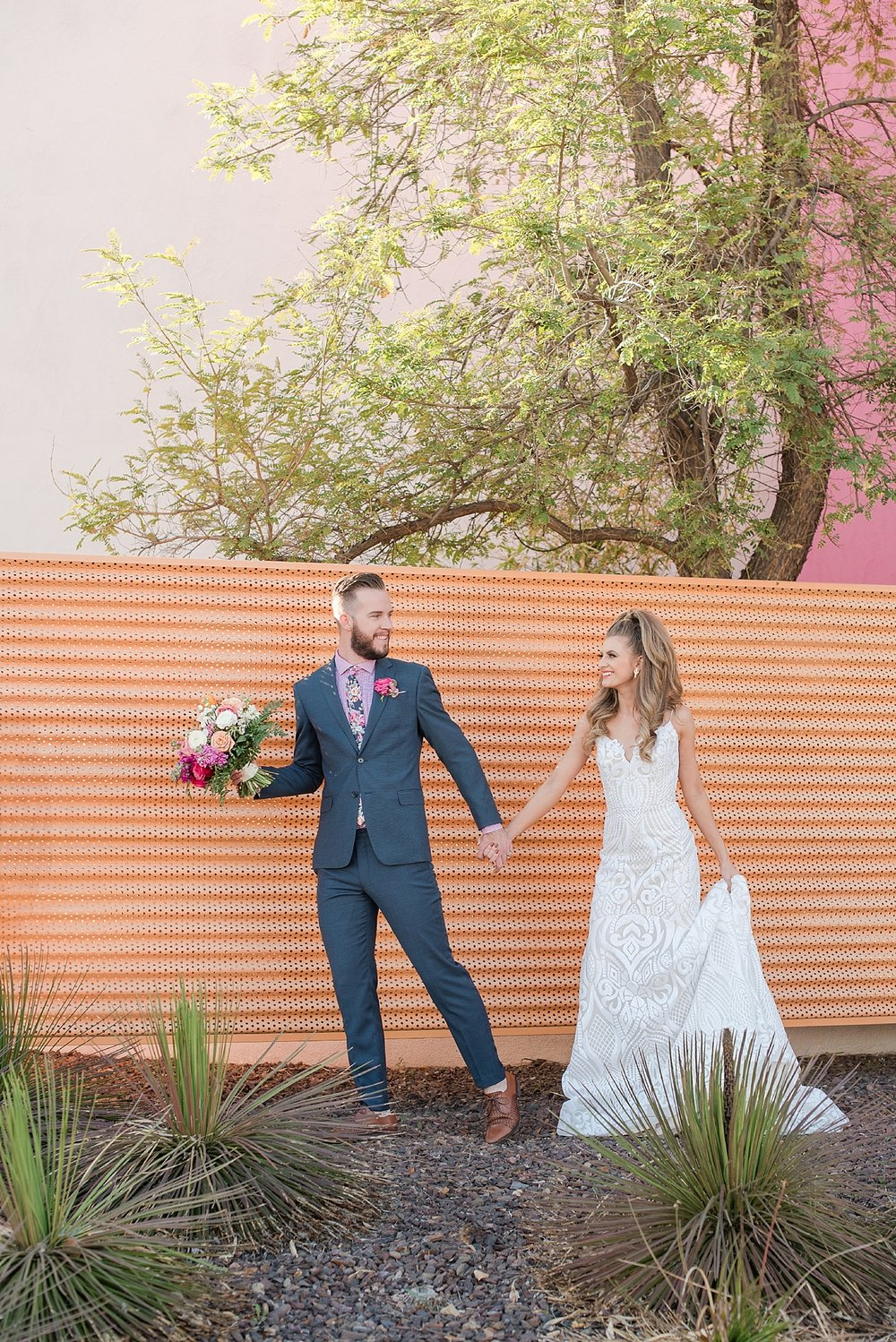 Gorgeous bride Natalie Meyer wearing a dress by Bella Lily Bridal, with her groom Zach Meyer at The Saguaro Scottsdale. Hair and makeup was done by Makiaj Beauty. Grooms tux was provided by Magro Clothing.