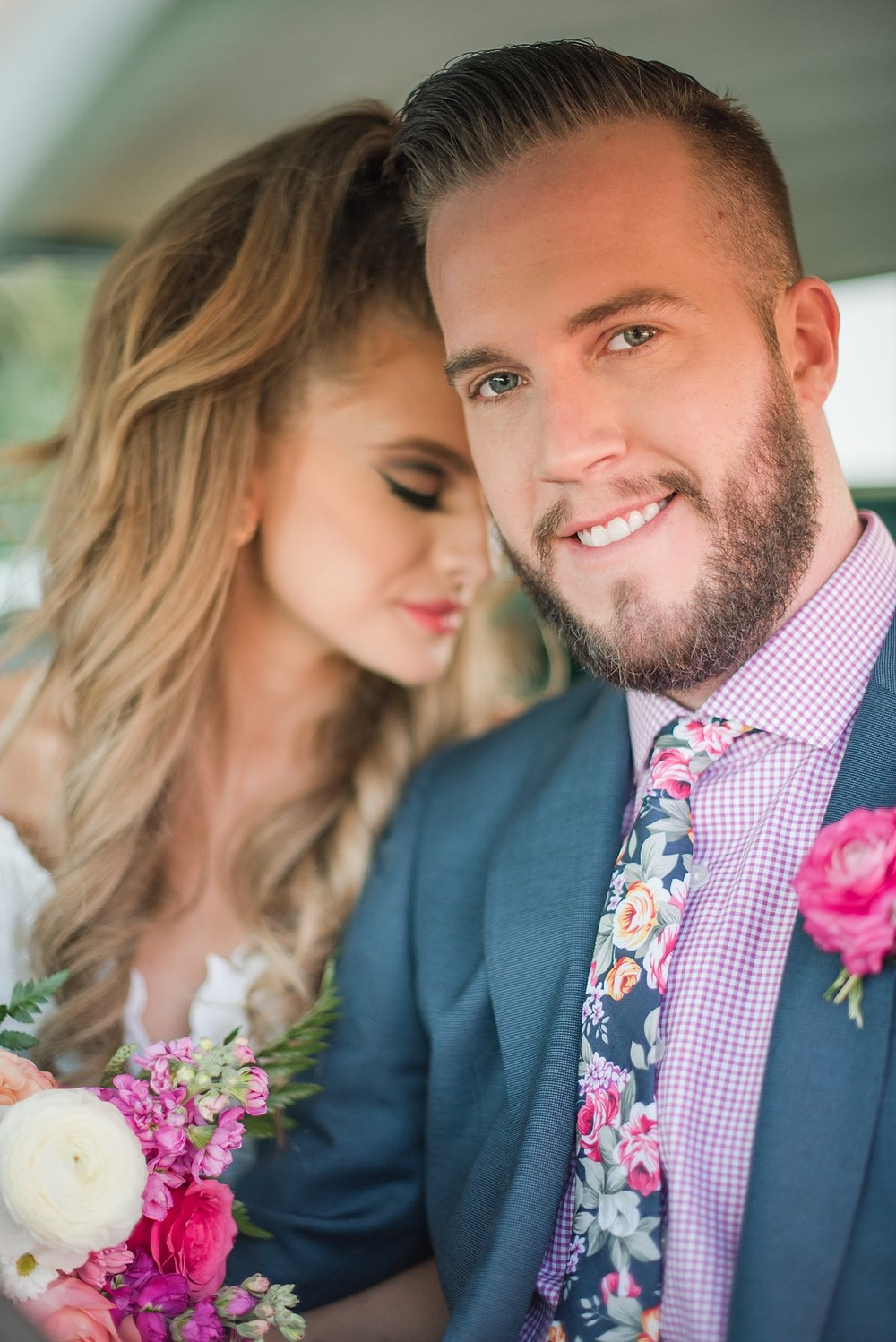 Vintage car provided by Roscoe + Louie. Bride Natalie Meyer wearing a dress by Bella Lily Bridal, with her groom Zach Meyer at The Saguaro Scottsdale. Hair and makeup was done by Makiaj Beauty. Groom's tux was provided by Magro Clothing. Photos by Jade Min Photography.