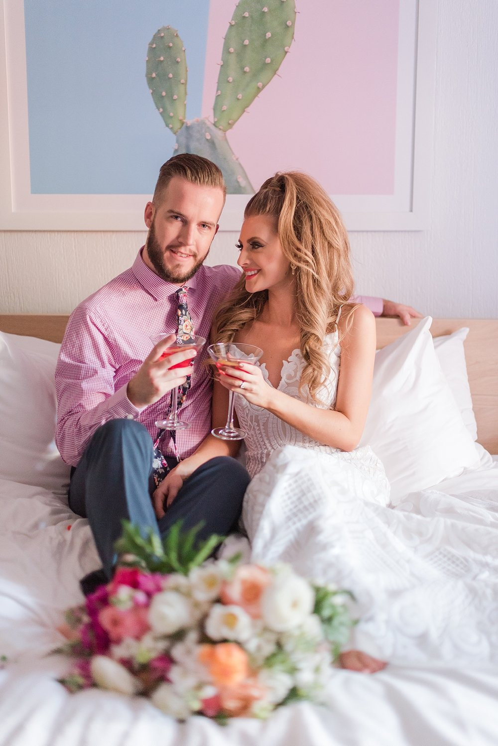 Gorgeous bride Natalie Meyer wearing a dress by Bella Lily Bridal, with her groom Zach Meyer at The Saguaro Scottsdale's Honeymoon Suite. Hair and makeup was done by Makiaj Beauty. Groom's tux was provided by Magro Clothing.