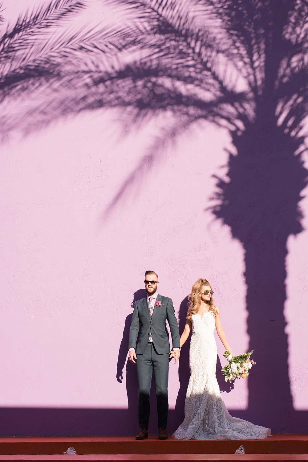 Bride Natalie Meyer wearing a dress by Bella Lily Bridal, with her groom Zach Meyer at The Saguaro Scottsdale's grounds. Hair and makeup done by Makiaj Beauty, and groom's tux provided by Magro Clothing.