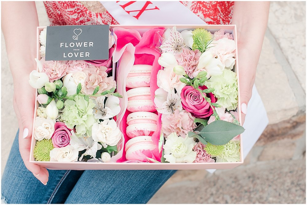 Beautiful box filled with an arrangement of lovely flowers and delicious French macarons made with love by Flower from Lower, and held by Miss Phoenix 2017 Alyssa Scofield. Photo taken by Jade Min Photography.