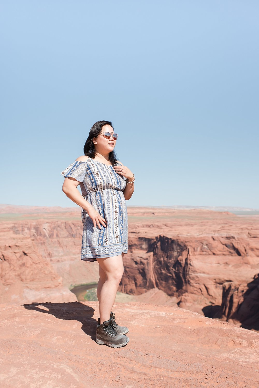 Darlynne looking stylish at Horseshoe Bend during late morning near Page, Arizona. Travel photo by Jade Min Photography.