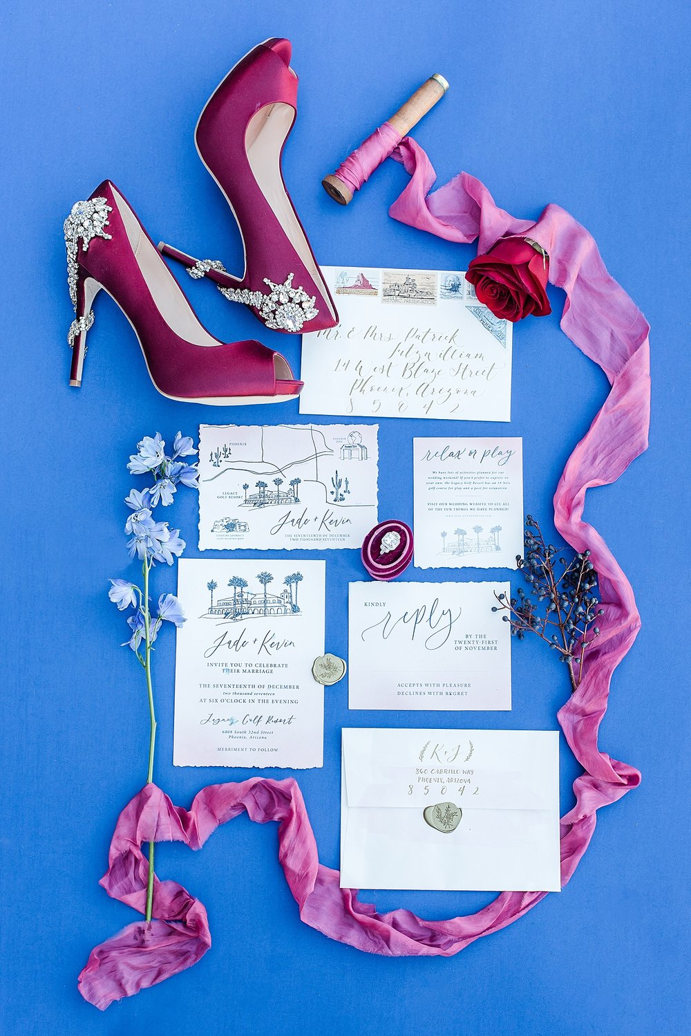 The elegant calligraphy by Holly of Sablewood Paper Company really elevated the stationery to another level. She custom made the invitation suite to showcase the Legacy Golf Resort as well as fun places to visit nearby. I highly recommend her for all of your wedding stationery needs. For more information and to see more of her beautiful work, please visit  here .  I had so many ideas on how to photograph Holly's beautiful work, but have to admit this shot is my favorite! Pictured here are my Badgley Mischka shoes, ring box by  The Family Joolz , delicate hand dyed silk ribbon from  Paperie and Silk , Holly's gorgeous stationery, and loose florals from Aubri of AZ Flower Fix.