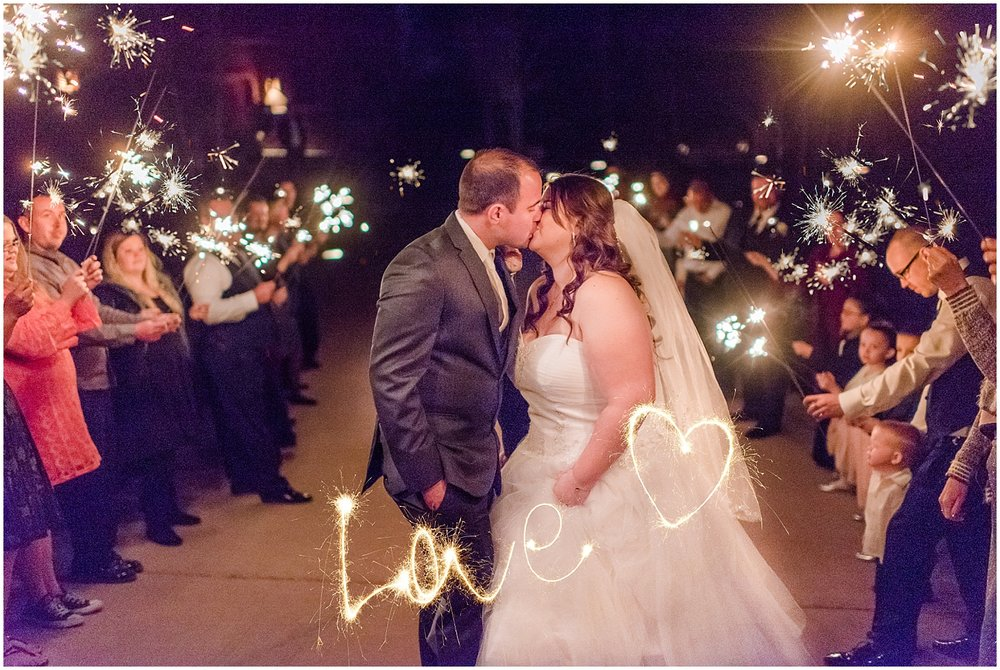 Sparkler exit at Sarah and Brendan Rhodes Wedding in Prescott, Arizona. Photos by Jade Min Photography, based out of Gilbert, Arizona.