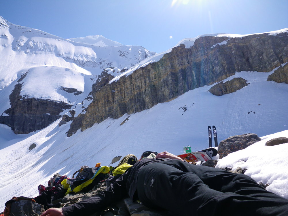 Eric Hjorleifson resting below the North Face of Mt. Clemenceau.