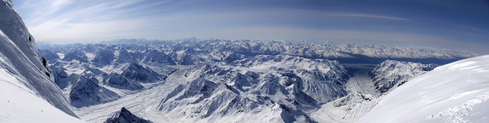 Pano of Alaskan peaks with ski objectives everywhere.