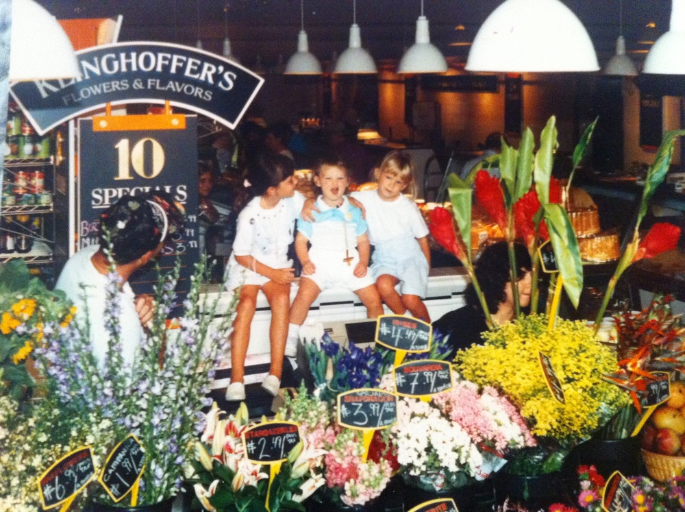 Steve's three girls in 1990 at their flower stand in the original Ardmore Farmer's Market in Suburban Square