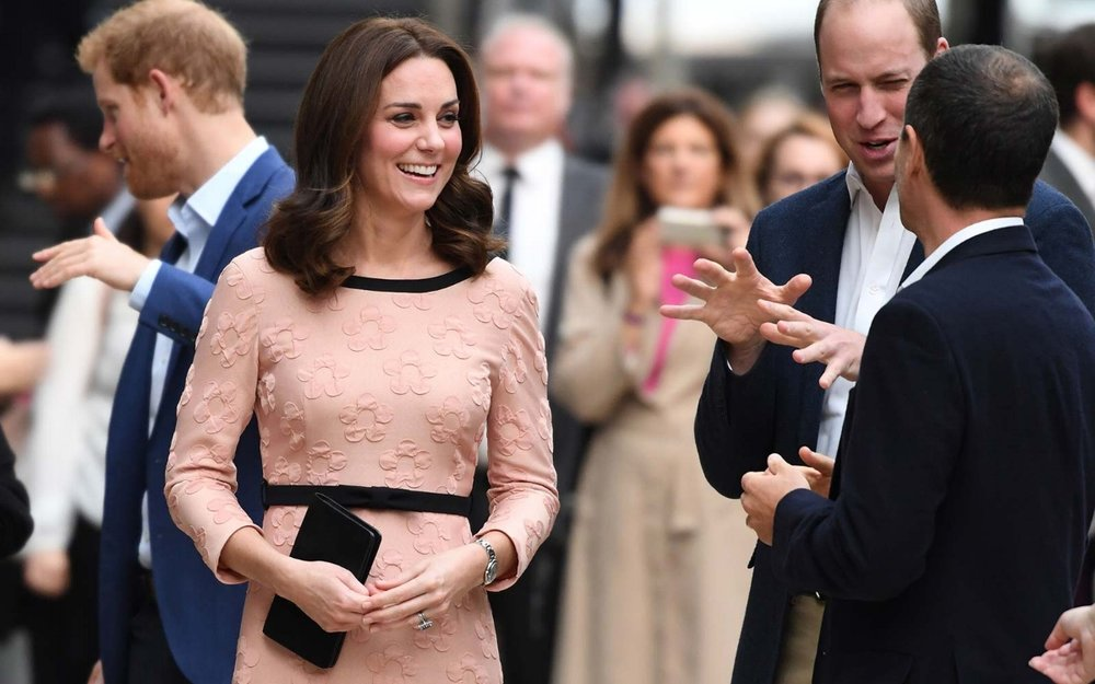 HRH The Duchess of Cambridge wears an Orla Kiely dress. (Photo credit: Chris J Ratcliffe/Getty)