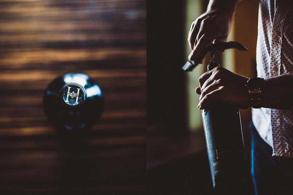 Sommelier, J.D. Wagoner, uncorks a bottle of wine at Restaurant Orsay in Jacksonville, Florida.