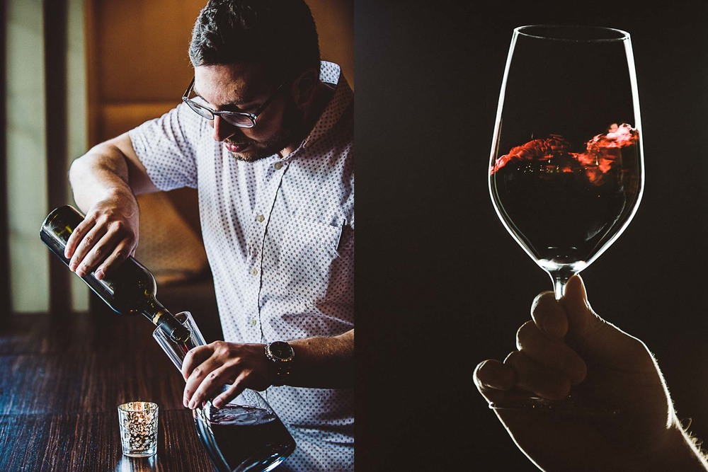 Sommelier decants a cabernet sauvignon and swirls it around in the wine glass to release the bouquet.
