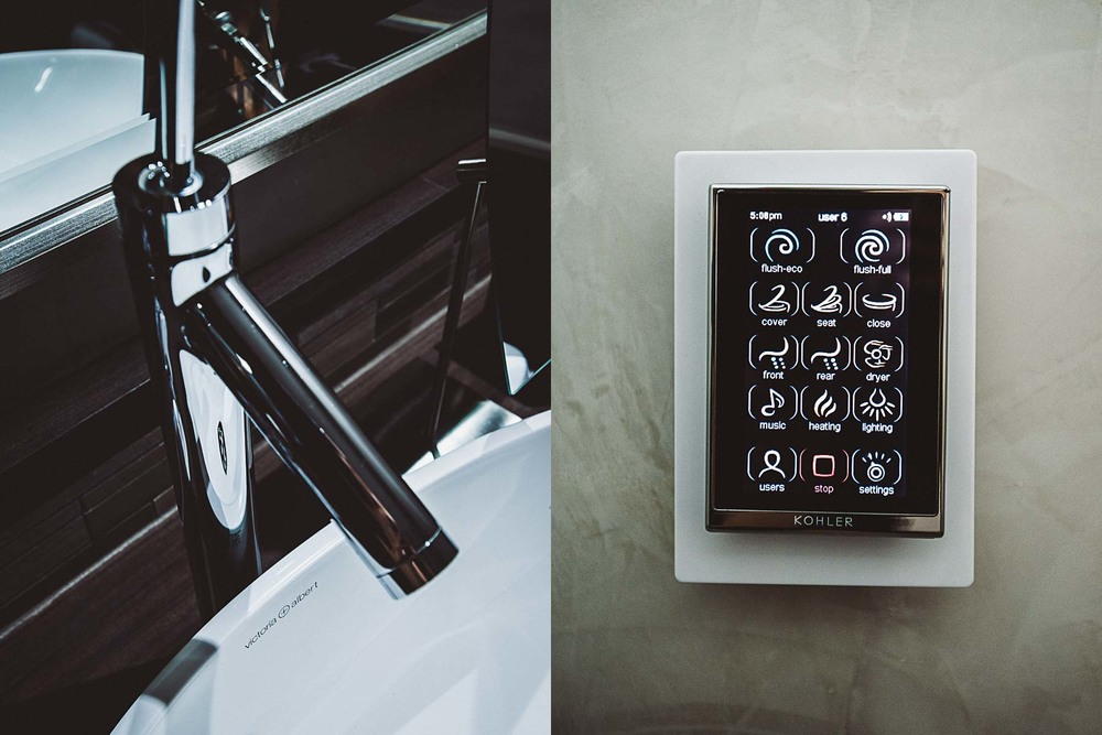 Modern fixtures adorn the bathroom and, yes, that's the remote control for the loo!