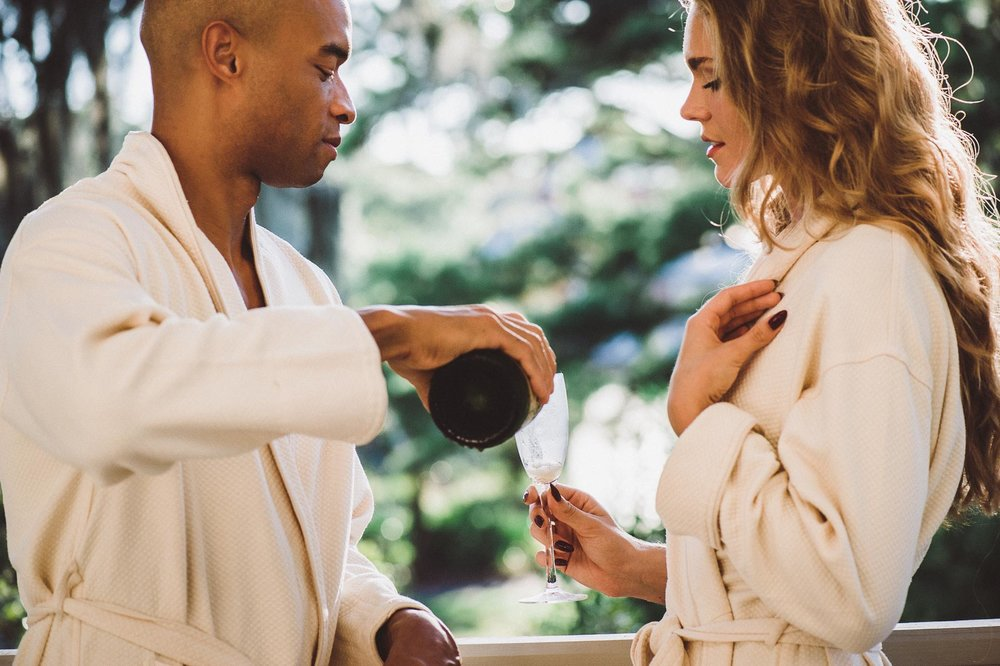 Couple enjoy champagne at the Omni, Amelia Island Spa.