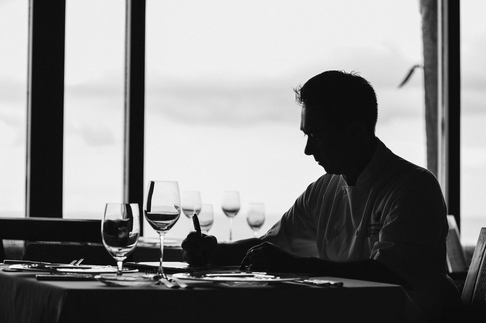 Chef Rick Laughlin planning the evening's menu at the Ritz-Carlton, Amelia Island, Florida.