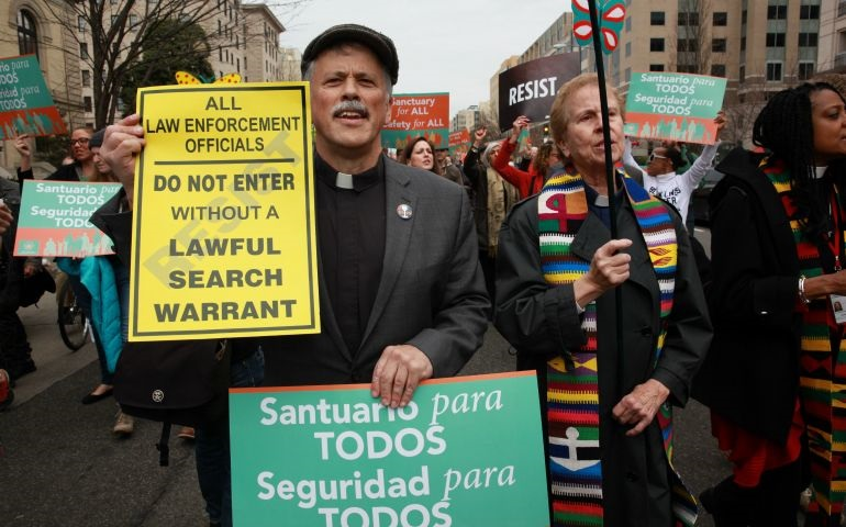 """In March 2017, Rev. Chuck joins several dozen clergy in a march to The White House as part of the inauguration of DMV Sanctuary Congregation Network. See Colman McCarthy's  """"Presbyterian pastor stands with today's sanctuary movement"""" ."""