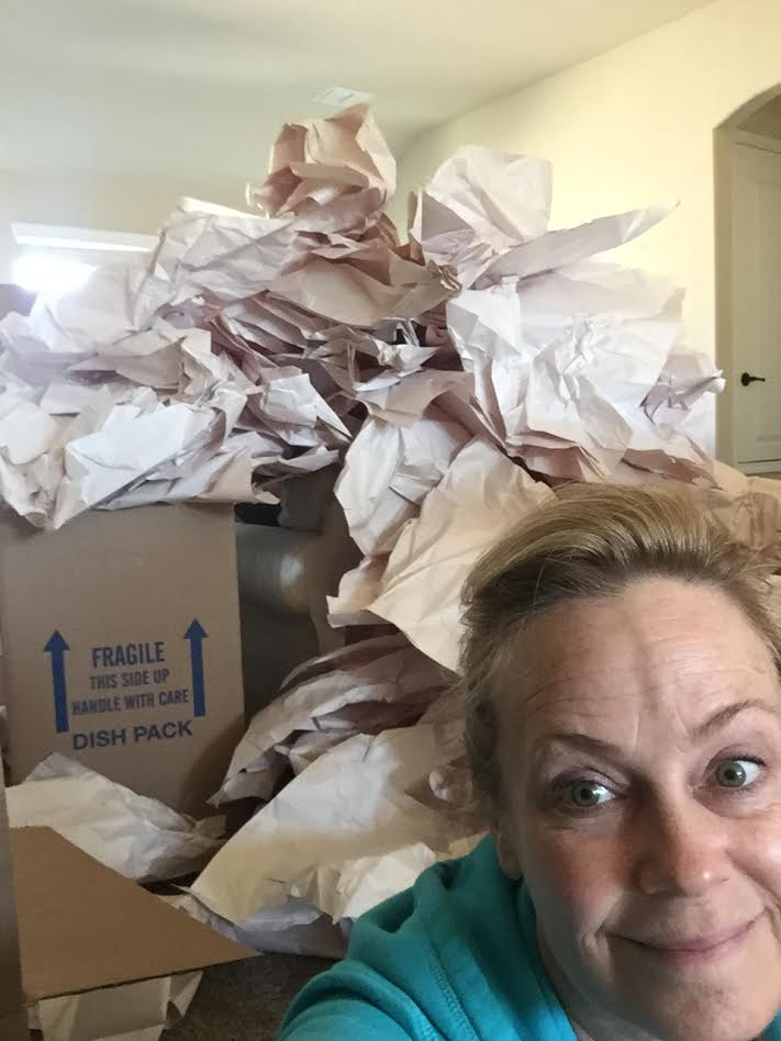 Ugh... no more make up, no more pretty smiles... just boxes, paper, and way too much stuff!