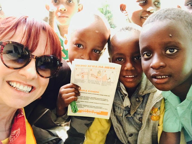 Dr. T in Tanzania - These children are excited to show off their Rabies Vaccine Card!