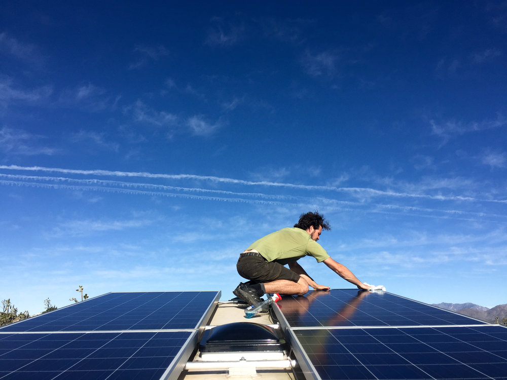 LSRF Jerud cleaning solar panels.jpg