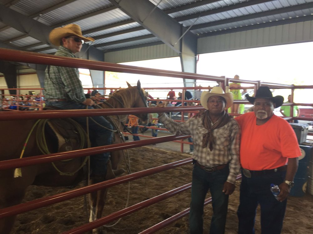 Frank Milano (orange shirt) and Alfredo Andrade (of Honduras) talk with Nick Gas (cowboy pastor and horse trainer) in a break in the action at the Denton County bull riding event put on in honor of Alfredo's son, Sergio, who was a professional bull rider and friend of ours who was murdered a couple of years ago.
