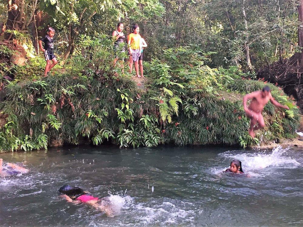 Kekchi kids enjoy swimming in their favorite swimming hole.