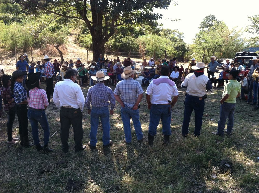 Our first meeting with friends and family of the cattlemen's association in Quesada, Guatemala. Manrique is in the light green shirt and black cowboy hat on the far right. Standing to his left is Cesar Gonzalez.