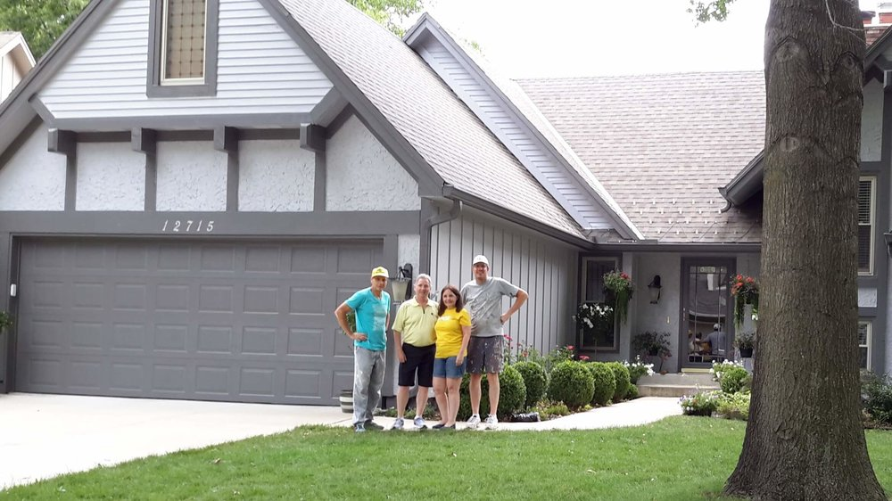 Steve and Bill with Mike and Roxanne Mathis after painting their house last week to help fund upcoming mission trips