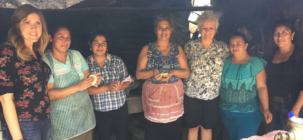 Laura Slaughter (left) and Carla Macias (third from the right) pose for a pic with the tortilla-making ladies.