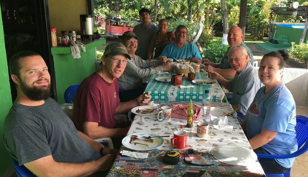 Pictured around the table with Cesar and Elba Gonzalez is the construction team from Second Baptist Springfield and First Baptist Avilla, Missouri.