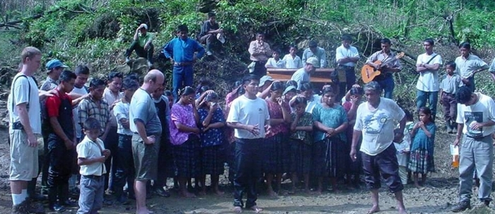 One of my treasured pictures from the beginning days of work in the jungle. This is the first baptism in Sepoc. Justin Hoskins and Jim Bogle are in the picture to the left. Jose, the leader of the village and future pastor, speaks to the group after the baptism. All those behind him who had been baptized, were about to be prayed over by the Christians present.