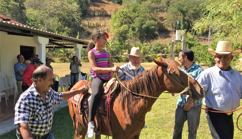 Equine therapy team riding.jpg