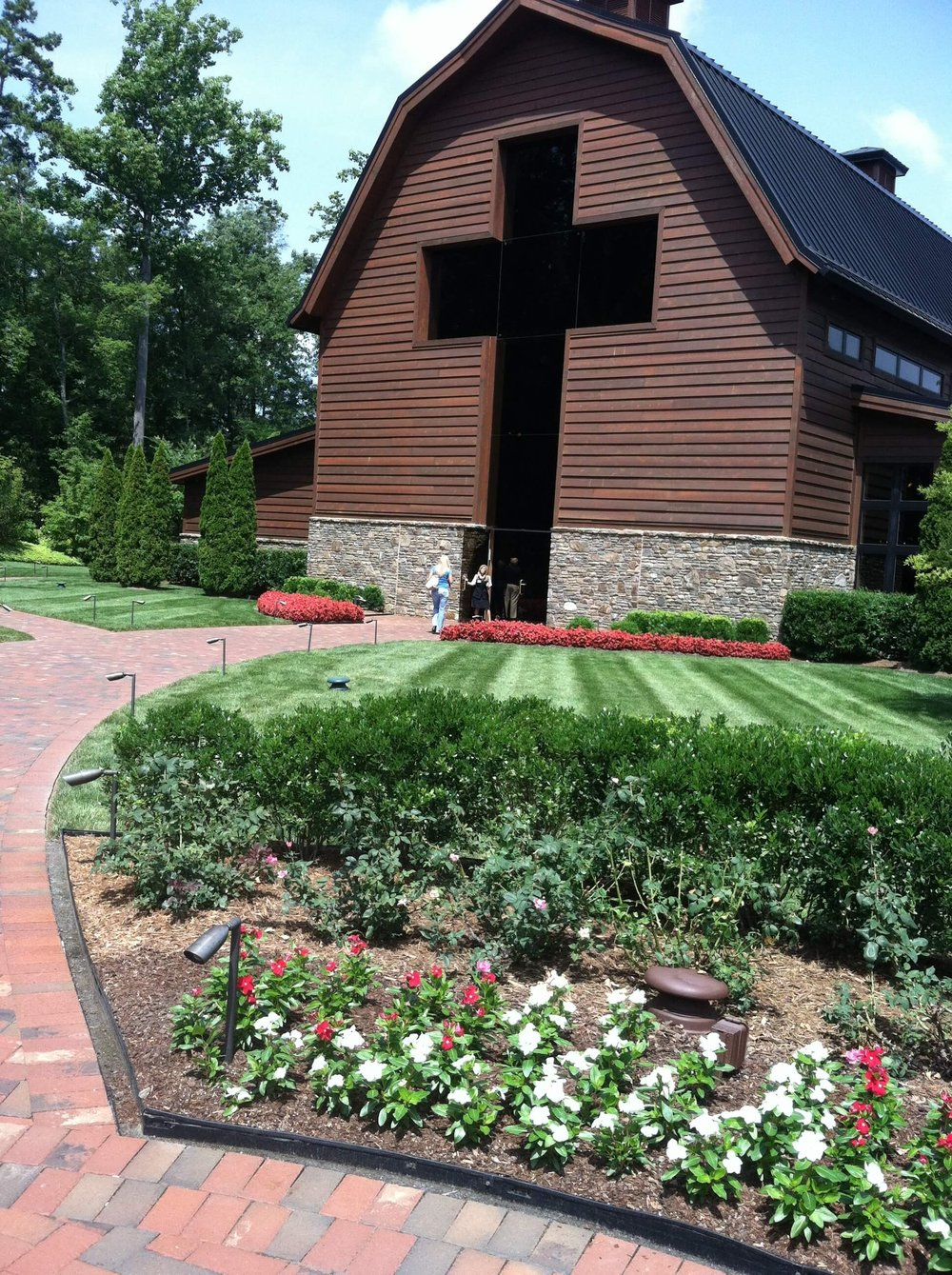 Here is the entrance to the Billy Graham library. You notice that you enter by the way of the cross. The building is built in the shape of a dairy barn to remember that Billy was a simple country boy who grew up on a dairy farm. At his home, Billy's father and several other men prayed that a great preacher of the Gospel would come from their town. Little did they know that 15 year old Billy, milking the cows in the barn, would be the answer to their prayers.